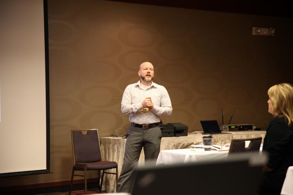Eric Browning speaking before his peers at the 2015 Sales Meeting.