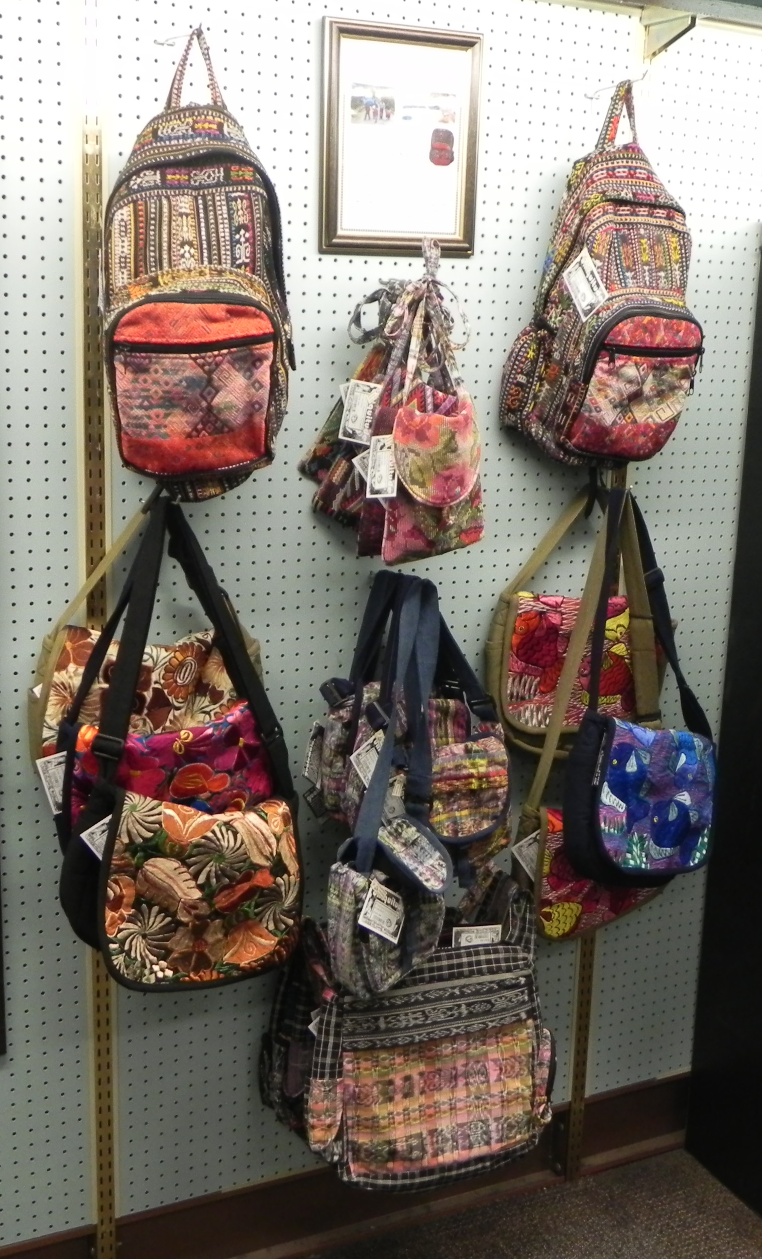 These bags and others like them are some of several fair-trade goods Beaver Bookstore sells.