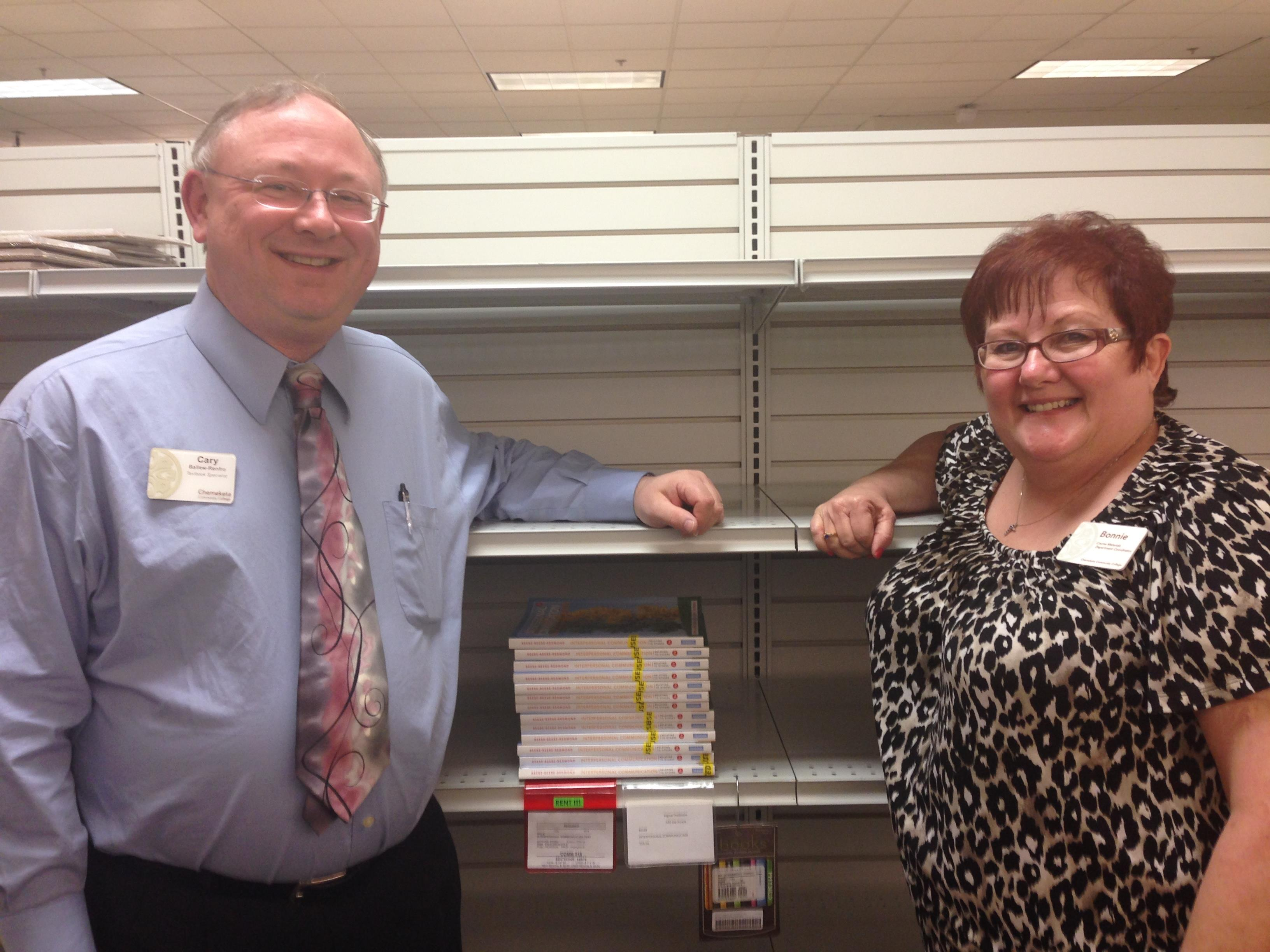 Cary Ballew-Renfro, Textbook Assistant, (left) and Bonnie Perry, Textbook Coordinator, show off the shelf talkers they credit with increasing ebook and rental sales.