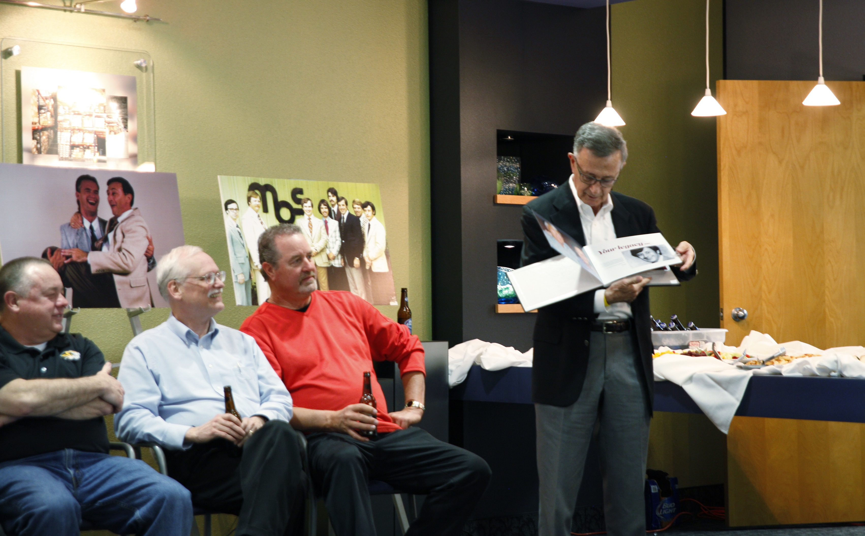 Steve Schwarz flips through a photo album presented to him at his retirement reception March 16. After 37 years with MBS, Schwarz retired in January.